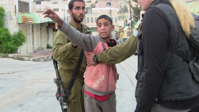 Muhammad Almayele , 9 , being arrested by soldiers