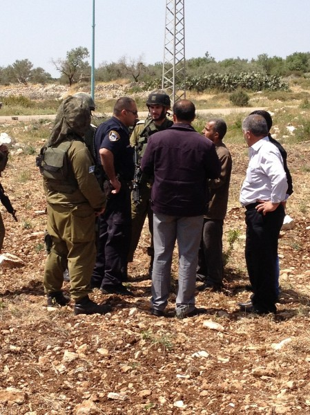 Israeli forces on Palestinian land (Photo by ISM)