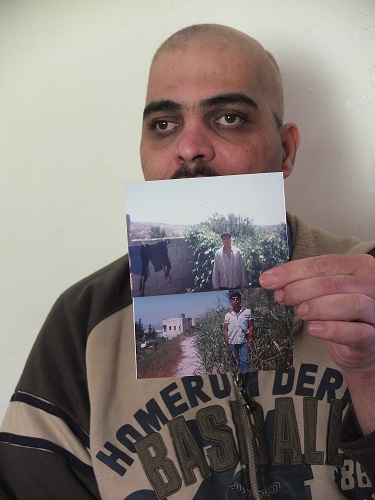 Ra'ed holds up photographs of himself before the attack