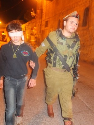 13 year old boy is arrested by an Israeli soldier