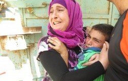 12 year old Ahmad being protected by the headteacher of the Qortoba School as he was being arrested