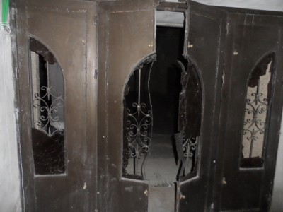 The front doors of one house look as if they were broken with more than human strength