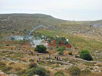 Teargas being shot at demonstrators in Deir Jarir