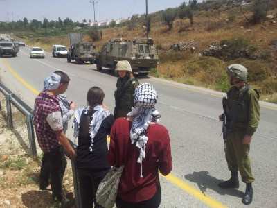 Palestinian activists protesting the denial of access to Nabi Saleh's land (Photo by ISM)