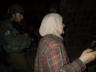 Zleikha Muhtaseb being arrested from her home