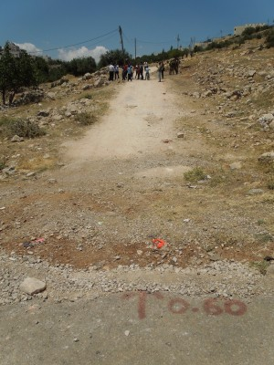 Road marker placed by settlers (Photo by ISM)