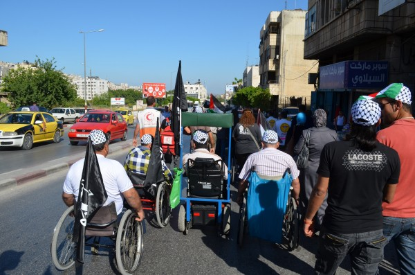 People marching along al-Quds Street in Nablus (Photo by ISM)