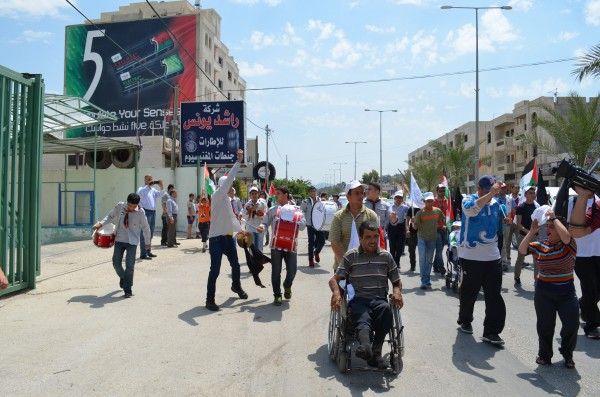 Palestinian Scout's band leading the demonstration (Photo by ISM)