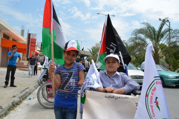 Two young demonstrators participating in the march (Photo by ISM)