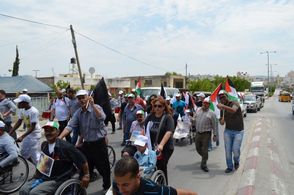 Demonstrators marching through Tulkarem (Photo by ISM)