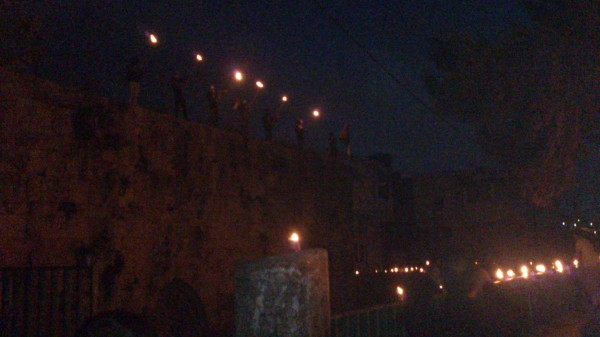 Villagers gathered in the village center, a municipal park area, to remember Palestinian displacement from 1948 Palestinian villages. Candles were lit as people gathered to remember the Nakba together. [Photo by Ahmad Kayed]