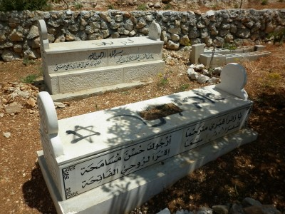 The two graves spraypainted, including a Star of David, a Jewish symbol co-opted by the Zionist movement