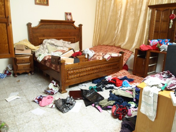 The ransacked home of arrested siblings Tahrir and Saddam
