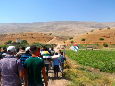 Demonstrators walking towards stolen Azmut land