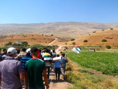 Demonstrators walking towards stolen Azmut land