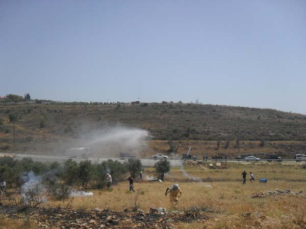 Skunk water truck spraying protesters (Photo by ISM)