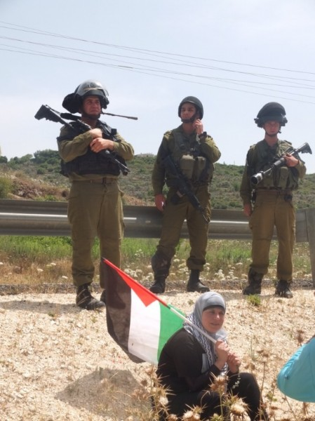 Israeli soldiers block residents of Nabi Saleh from reaching their stolen well