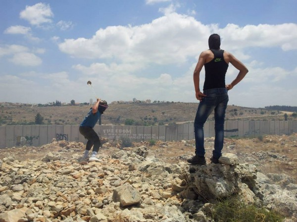Youth from Ni'lin with the Apartheid Wall visible in the background