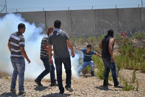 Tear gas thrown by Israeli soldiers in the middle of the crowd (Photo by: ISM)