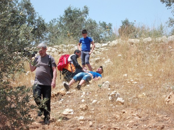 Injured protester being treated on spot by Red Crescent personnel (Photo by ISM)