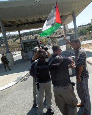 Protester being harassed by Israeli military in front of checkpoint