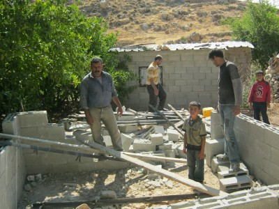 Residents of Ad Dawa around the demolished building (Photo by Ad Dawa municipality)