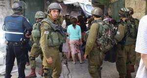 Settlers and soldiers block streets in the souq - restricting Palestinian movement