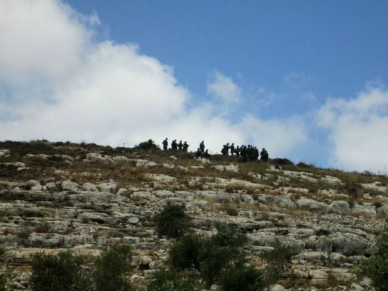 Israeli soldiers standing on the hilltop during the demonstration (Photo by IWPS)