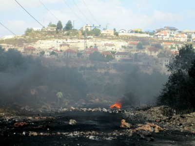 Tyre barricades burning (Photo by IWPS)