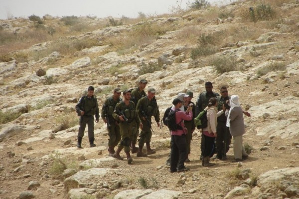 Palestinian shepherd arguing with Israeli border police officers just before he was detained (Photo by Operation Dove)