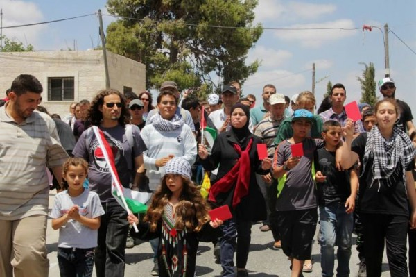 Protesters marching at last Friday demonstration in Nabi Saleh (Photo by Tamimi Press)