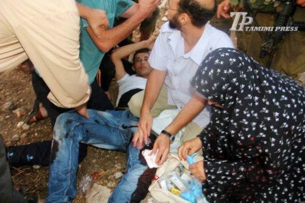 Mahmoud Tamimi receiving medical aid before he was evacuated by ambulance (Photo by Tamimi Press)