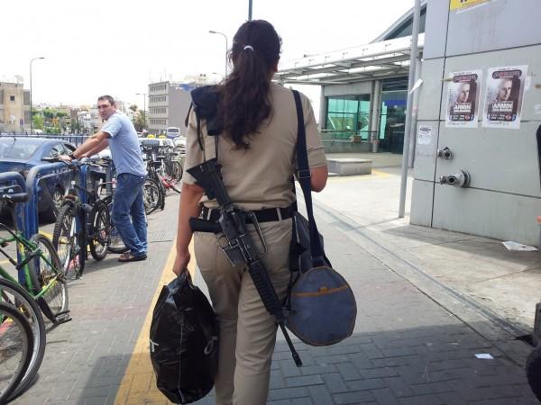 Israeli young female on the Israeli military service uniform