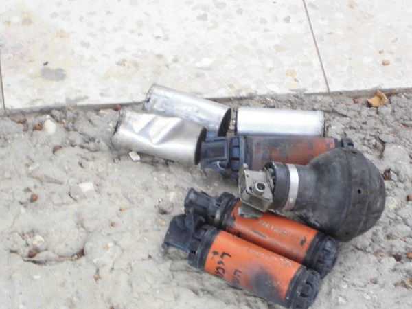 Tear gas canisters and sound bombs shot at protesters during the demonstration (Photo by IWPS)