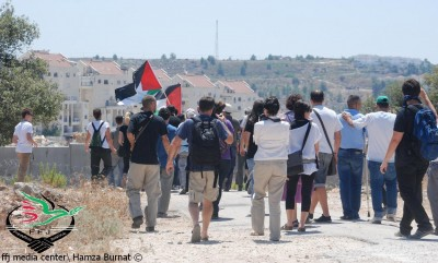 Protesters marching towards the wall in Bil'in (Photo by Hamza Burnat)