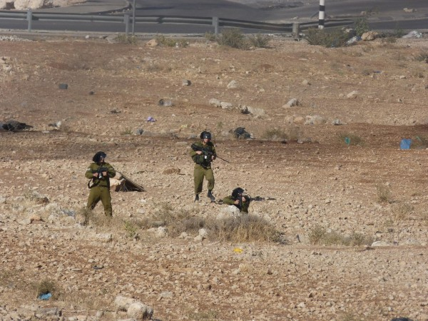 Israeli soldiers shooting rubber bullets close to the Bedouin community