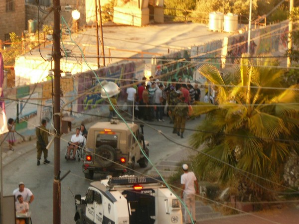 Settlers, soldiers and police gathered around the Abu Shamsiyah home following the attack (Photo by ISM)