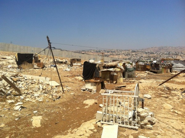 Apartheid Wall visible behind the community of 'Anata