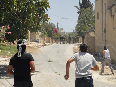 Youth of the village facing the force of the Israeli military