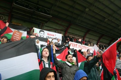 Pro-Palestinian activists hold a boycott protest during a football match between Scotland and Israel