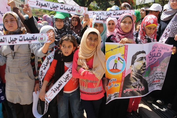 Young supporters of Dirar Abu Sisi rallied on Gaza on 10 July. (Photo by Joe Catron)