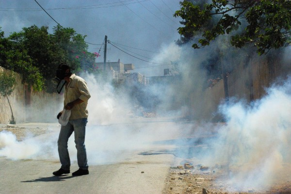 Teargas filling the streets of Kafr Qaddum village (photo by Sevenson Berger)