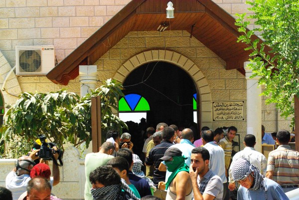 People fleeing the mosque after teargas was shot inside (photo by Sevnson Berger)