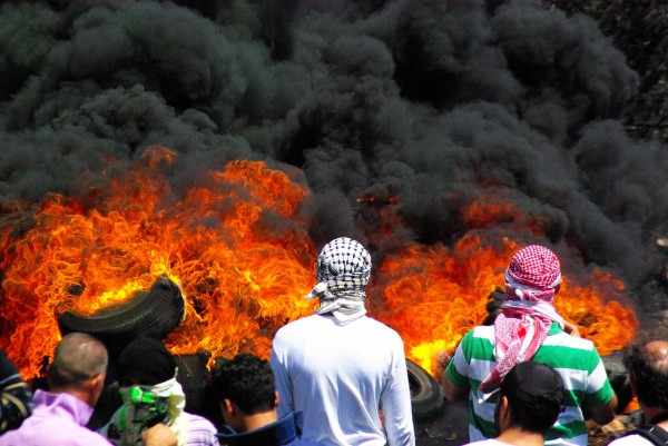 Protesters burning tyres, the smoke of which blew towards the illegal settlement of Qedumim (photo by Svenson Berger)
