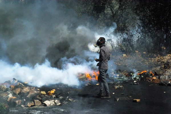 Protester on blocked road leading to Nablus (photo by Svenson Berger)