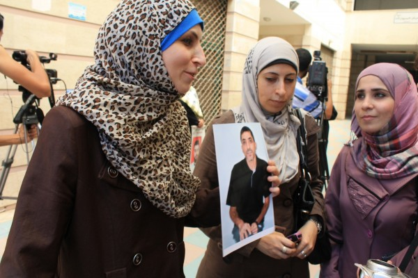 Veronika Abu Sisi, left, speaks with supporters. (Photo by Joe Catron)