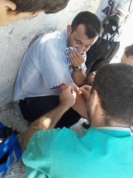 Protester treated by medic after being hit by teargas canister