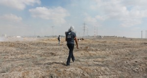 A demonstrator walks toward the separation barrier. (Photo by Joe Catron)