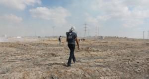A demonstrator walks toward the separation barrier. (Photo by Joe Catron)