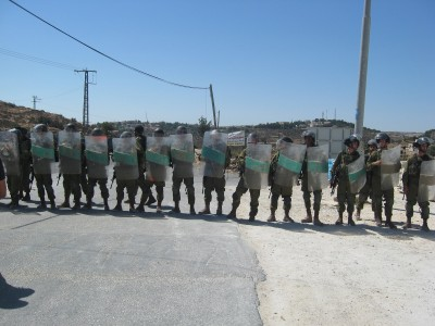 Soldiers blocked residents from reaching their own land (Photo by ISM)